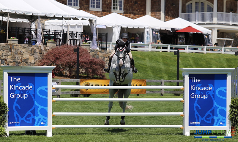 Georgina Bloomberg clears The Kincade Group fence on the Grand Prix Field at Old Salem Farm; photo © Jump Media