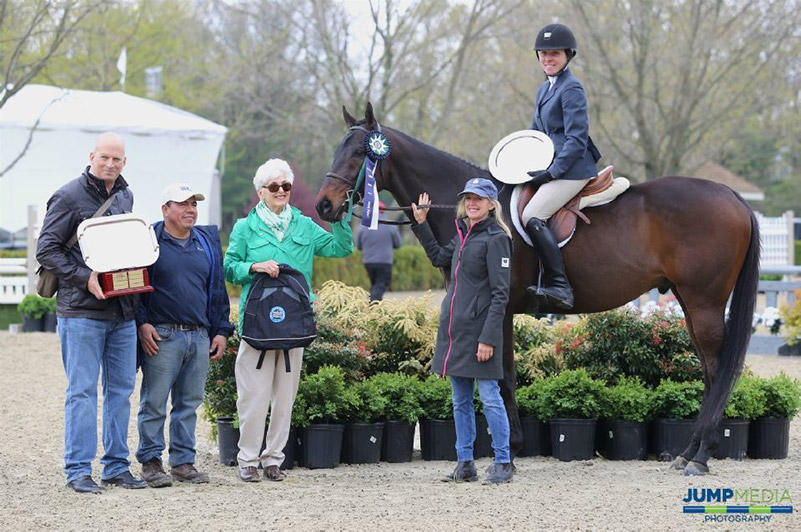 Keirstin Johnsen and Hennepin, along with owner Shelly Ferrall and groom Fidel Ventura, are awarded with the champion ribbon, as well as the Debby Malloy Winkler Memorial Trophy, donated by the Malloy Family and presented by Vivien and Mark Malloy; photo © Jump Media