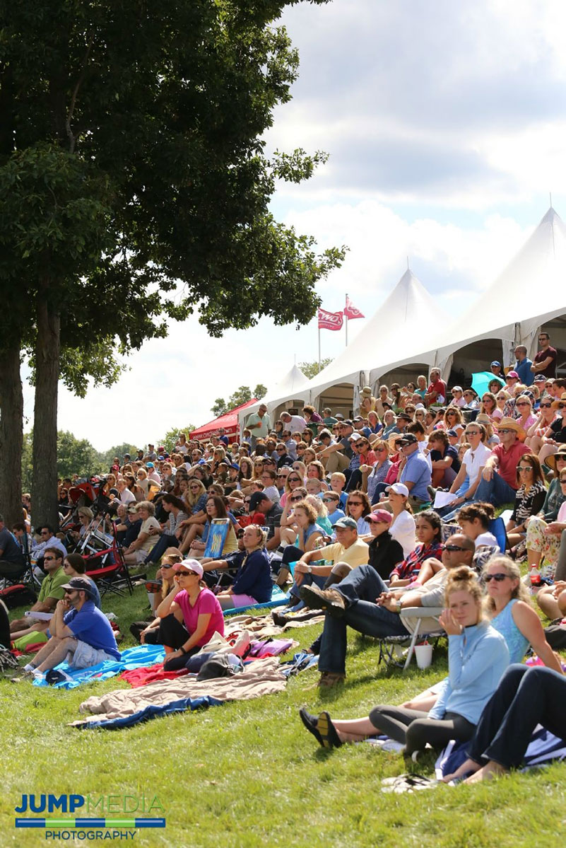 A crowd gathers on the banks of the Grand Prix Field at Old Salem Farm; photo © Jump Media