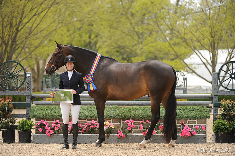 Kelly Tropin and Chablis in their winner's presentation; photo © The Book