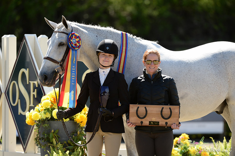 Aubrienne Krysiewicz-Bell Early Winter, pictured with trainer Dottie Areson of Heritage Farm, were champions in the Large Junior Hunter 16-17 Division, and earned the Grand Junior Hunter Championship on Sunday, May 14, during the 2017 Old Salem Farm Spring Horse Shows at Old Salem Farm in North Salem, NY; photo © The Book