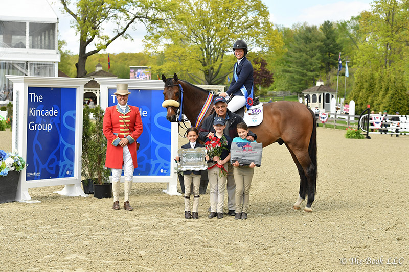 Beezie Madden and Breitling LS are presented as winners of the $50,000 Old Salem Farm Grand Prix, presented by The Kincade Group, by ringmaster Alan Keeley (left) and Kamran Hakim (right) of Old Salem Farm on Sunday, May 14, during the 2017 Old Salem Farm Spring Horse Shows at Old Salem Farm in North Salem, NY; photo © The Book