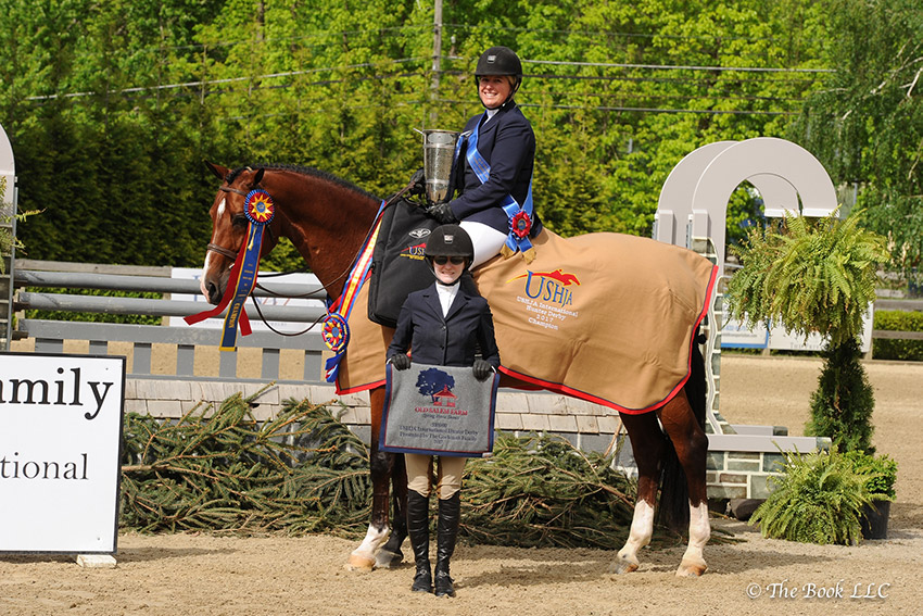 Becky Gochman presents Callie Seaman and Skorekeeper as winners of the $10,000 USHJA International Hunter Derby, presented by The Gochman Family, during the 2017 Old Salem Farm Spring Horse Shows at Old Salem Farm in North Salem, NY. Photo by The Book
