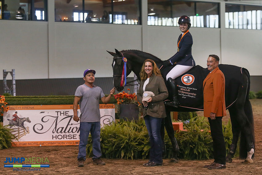 Madison Goetzmann, aboard San Remo VDL with groom Oscar Lopez and trainer Stacia Madden, is presented as winner of the Region 2 ASPCA/NHSAA Maclay Championship by Mason Phelps, representing the CP National Horse Show. Photo by Jump Media