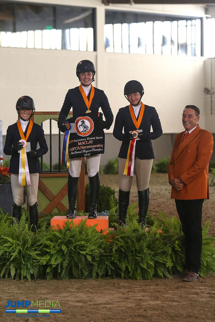 The Region 2 ASPCA/NHSAA Maclay Championship top three Madison Goetzmann (middle), Samantha Cohen (right), and Taylor St. Jacques (left) with Mason Phelps, representing the CP National Horse Show. Photo by Jump Media