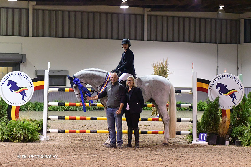 Sydney Shulman and Quidam 13 are presented as winners of the $5,000 1.30m Jumper Prix, presented by Maarten Huygens Horse Sales, by Maarten Huygens (left) and Chelsea Dwinell (right) of Old Salem Farm during Friday Jumper Night at the Old Salem Farm Fall Classic at Old Salem Farm in North Salem, NY. Photo by SEL Photography