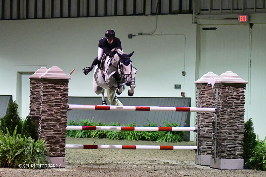 Sydney Shulman topped the $5,000 1.30m Jumper Prix, presented by Maarten Huygens Horse Sales, riding Quidam 13 during Friday Jumper Night at the Old Salem Farm Fall Classic at Old Salem Farm in North Salem, NY. Photo by SEL Photography