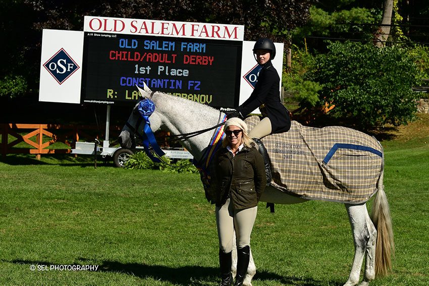 "Layla Kurbanov and Constantin FZ are presented as winners of the Child/Adult 2'6"" Hunter Derby by Chelsea Dwinell of Old Salem Farm at the Old Salem Farm Fall Classic in North Salem, NY. Photo by SEL Photography"