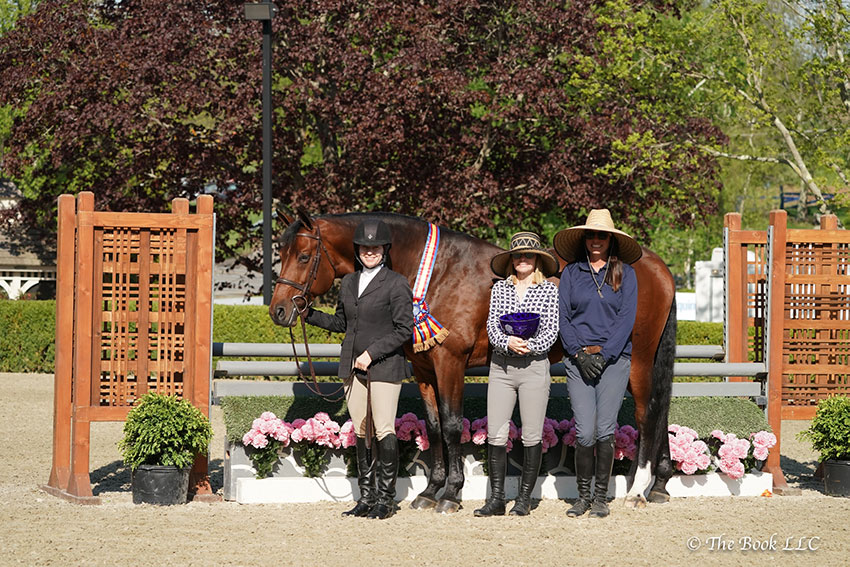 True Story, ridden by Holly Orlando (left), owned by Cathy Zicherman (center), and trained by Jenny Dunion (right), was named Grand Hunter Champion on Wednesday, May 9, during the 2018 Old Salem Farm Spring Horse Shows at Old Salem Farm in North Salem, NY. Photo by The Book