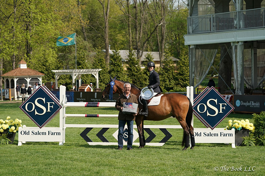 Sydney Shulman is presented as winner of the $10,000 New York Speed Stake CSI2* by Old Salem Farm Manager Alan Bietsch on Thursday, May 10, during the 2018 Old Salem Farm Spring Horse Shows at Old Salem Farm in North Salem, NY. Photo by The Book