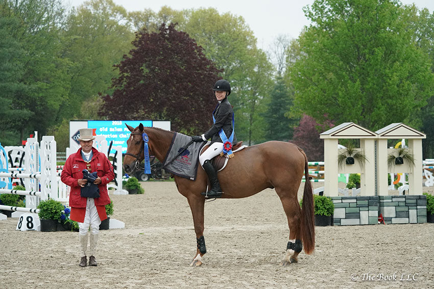 Elli Yeager and Copperfield 39 are presented as winners of the $5,000 Equitation Challenge by ringmaster Alan Keeley at the 2018 Old Salem Farm Spring Horse Shows at Old Salem Farm in North Salem, NY. Photo by The Book