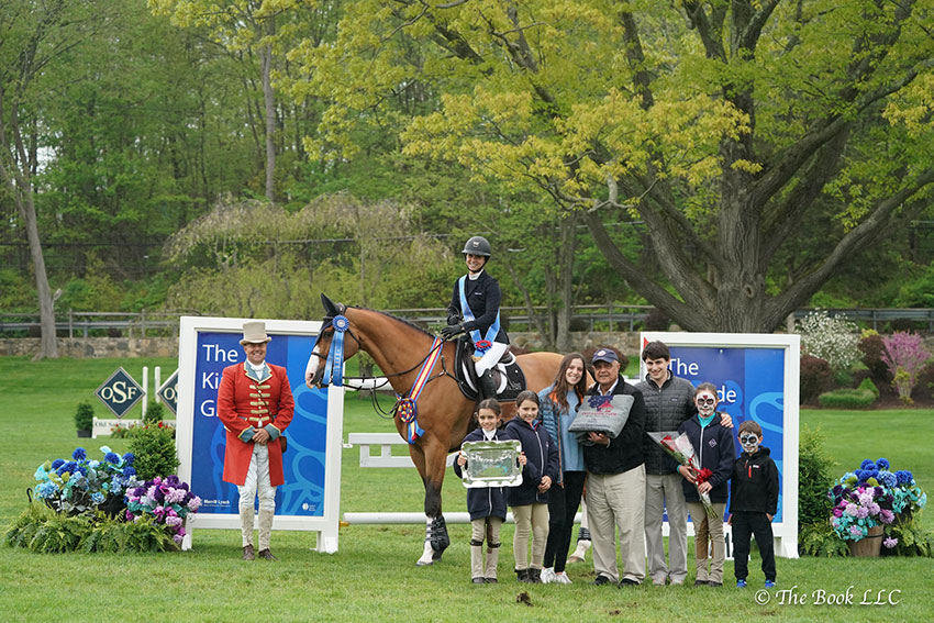 Adrienne Sternlicht and Toulago are presented as winners of the $50,000 Old Salem Farm Grand Prix CSI2*, presented by The Kincade Group, by Old Salem Farm owner Kamran Hakim and family on Sunday, May 13, during the 2018 Old Salem Farm Spring Horse Shows at Old Salem Farm in North Salem, NY. Photo by The Book