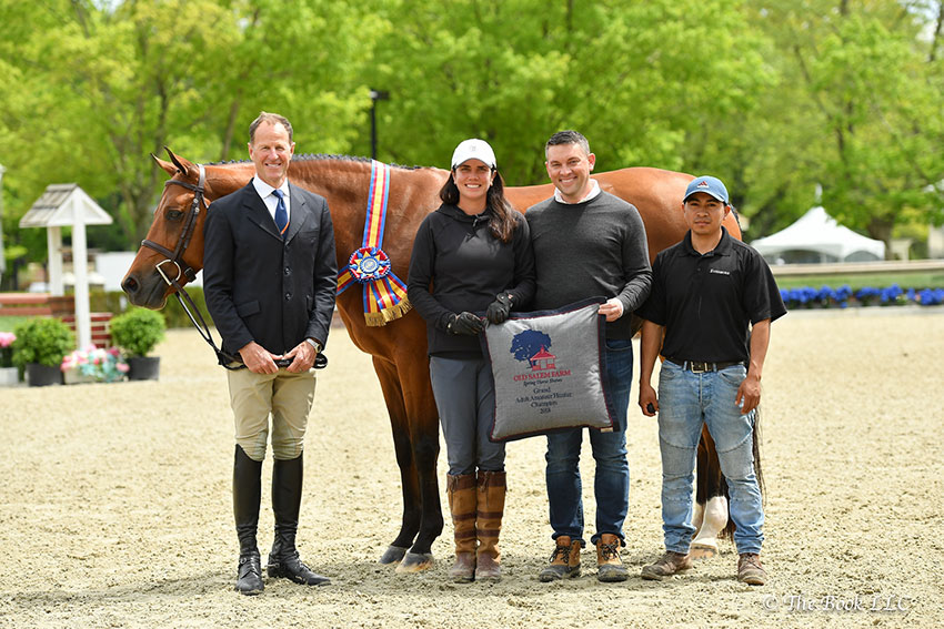 Forever, ridden by James Anderson of New York, NY, was named Grand Adult Amateur Hunter Champion on Thursday, May 17, during the 2018 Old Salem Farm Spring Horse Shows at Old Salem Farm in North Salem, NY, pictured here with trainer Jenny Dunion, John Talley, and Leo Guevara. Photo by The Book