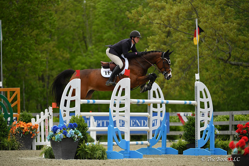 Ireland's Cormac Hanley won the $6,500 Open Jumper 1.35m riding Cora 572 on Friday, May 18, during the 2018 Old Salem Farm Spring Horse Shows at Old Salem Farm in North Salem, NY. Photo by The Book
