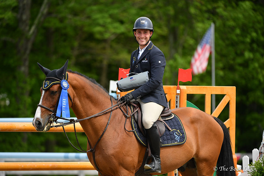 Mattias Tromp of North Salem, NY, and Avon are presented as winners of the $5,000 Under 25 Jumper 1.45m on Friday, May 18, during the 2018 Old Salem Farm Spring Horse Shows at Old Salem Farm in North Salem, NY. Photo by The Book