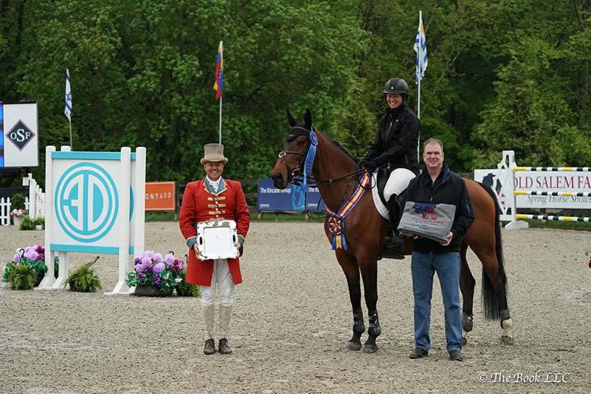 Beezie Madden and Jiva are presented as winners of the $35,000 Old Salem Farm Jumper Classic, presented by Douglas Elliman Real Estate, by Michael Fitzgibbon, Executive Manager of Sales at Douglas Elliman, on Saturday, May 19, during the 2018 Old Salem Farm Spring Horse Shows at Old Salem Farm in North Salem, NY. Photo by The Book