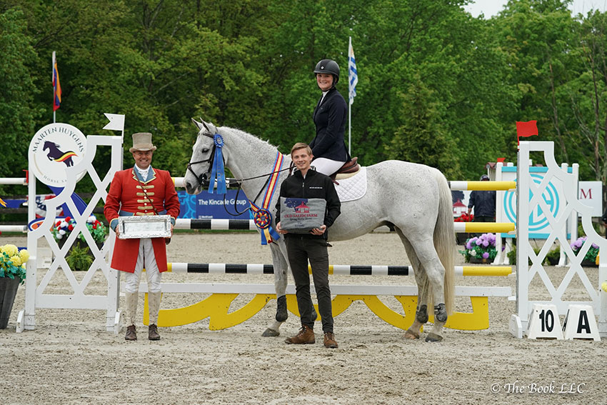 Katherine Strauss (pictured on Capacity) is presented as winner of the $15,000 Under 25 Grand Prix, presented by Miller Motorcars, by Dan King of Miller Motorcars on Saturday, May 19, at the 2018 Old Salem Farm Spring Horse Shows at Old Salem Farm in North Salem, NY. Photo by The Book