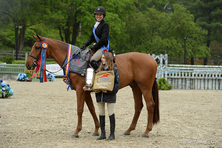 Keirstin Johnsen, owner Summer Witherspoon, and Aster de la Cense are presented as winners of the $15,000 USHJA International Hunter Derby, presented by The Gochman Family, on Saturday, May 19, at the 2018 Old Salem Farm Spring Horse Shows at Old Salem Farm in North Salem, NY. Photo by The Book
