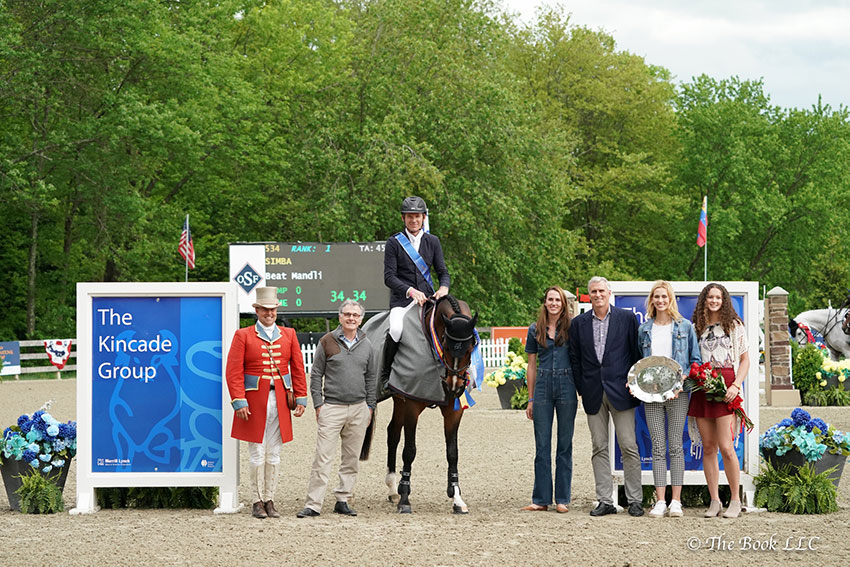 Beat Mändli and Simba were presented as the winners of the $131,000 Empire State Grand Prix CSI3*, presented by The Kincade Group, on Saturday, May 20, during the 2018 Old Salem Farm Spring Horse Shows at Old Salem Farm in North Salem, NY, by (left to right), ringmaster Alan Keeley, owner Jamie Dinan, and The Kincade Group representatives Gretchen Kincade, Stephen Kincade, Nicole Kincade, and Elena Kincade. Photo by The Book